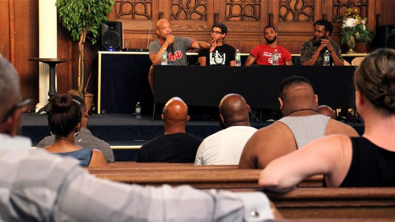 About 45 people attended a racial profiling workshop organized by Will Mega. Panelists included four Philadelphia educators (from left) Mega, Ismael Jimenez, Quamiir Trice, and Ben Slater, who detailed their recent experiences with racial profiling. (Emma Lee/WHYY)