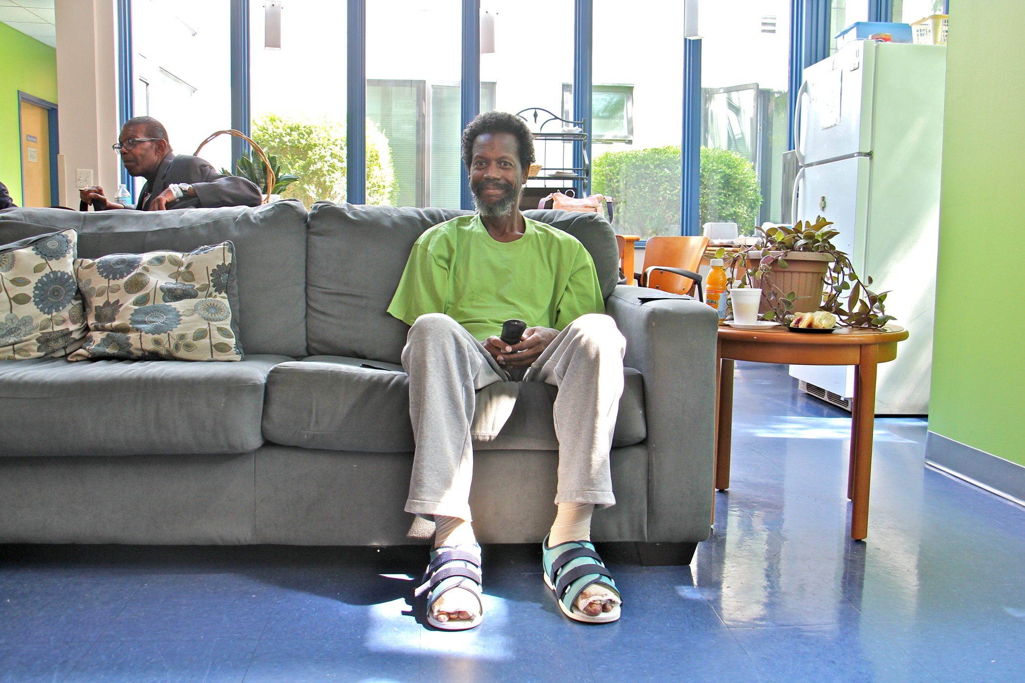 Rodney Lane, 57, relaxes in the common room at Serenity Court. After hospital treatment for frostbite and pneumonia, Lane was discharged to Serenity Court so he could get the continuing treatment he requires.