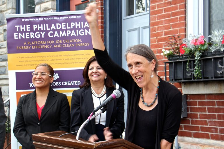Homeowner Joan Kimball celebrates her home's conversion to solar power under a the Philadelphia Energy Campaign. Kimball's home, on Fairmount Avenue, became the 150th to go solar since the launch of the campaign to promote clean energy and create jobs