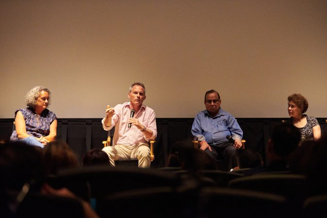 (From left) Executive Producer Elisa Gambino; Director Neal Broffman; father, Akhil Tripathi;  and mother, Judy Tripathi; during a Q&A after a screening of 2015 documentary, Help Us Find Sunil Tripathi. The documentary was screened in Sunil's hometown for the first time on July 26, 2018, at the Bryn Mawr Film Institute, in Sunil's hometown. (Natalie Piserchio for WHYY)