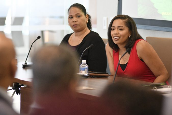 Gia Morón, executive vice president of WomenGrow, and Desirée Ivey, Philadelphia market leader for WomenGrow, participate in a forum on the business of medicinal and recreational use of cannabis in the African-American community. (Bastiaan Slabbers for WHYY)