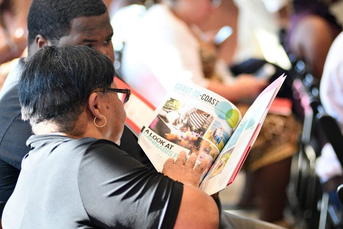 Audience members look over literature at a forum on the business of medicinal and recreational use of cannabis in the African-American community, at an event held on Thursday. (Bastiaan Slabbers for WHYY)