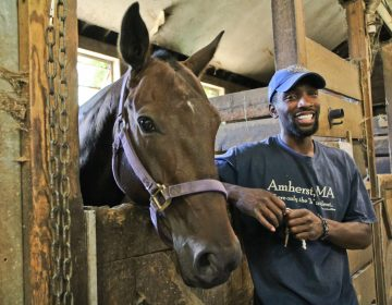 Daymar Rosser started at the Work to Ride program when he was 5, eventually playing polo for and graduating from Roger Williams University in Rhode Island. (Kimberly Paynter/WHYY)