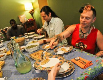 Francis Rose Subbiando serves plantains after a talk on the history of Creole Philadelphia at a Faemily Table dinner at her home in West Philadelphia. (Kimberly Paynter/WHYY)