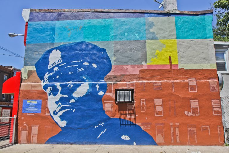 A new mural at 29th and Ridge Avenue honors Sergeant Robert Wilson III who lost his life in the line of duty. (Kimberly Paynter/WHYY)
