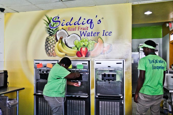 Dean Maitir and Hamir Jews serve ice cream at Siddiq's Water Ice in West Philadelphia. (Kimberly Paynter/WHYY)