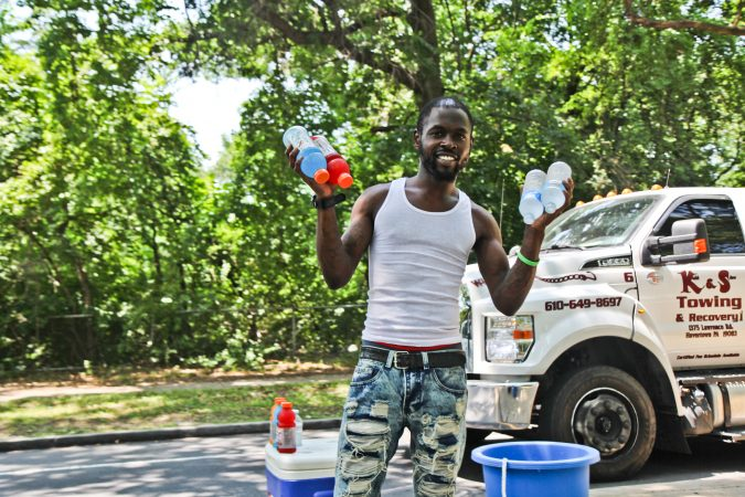 A man sells water and Gatorade in Fairmount Park in the midst of a heat wave with temperatures in the mid- to upper 90s expected throughout the week. (Kimberly Paynter/WHYY)