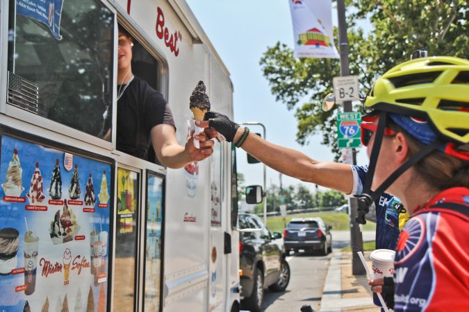 Cyclists purchase ice cream after a ride from Wilmington to Philadelphia. (Kimberly Paynter/WHYY)