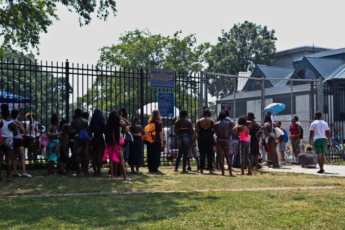 The line to get into the John B. Kelly Pool indicates an hour wait during an historic heat wave in Philadelphia. (Kimberly Paynter/WHYY)
