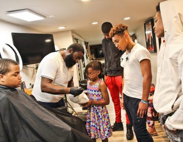 P. Micheal Boone instruct Jr. Barber Academy students in the art of the shape up during the second week of class. (Kimberly Paynter/WHYY)