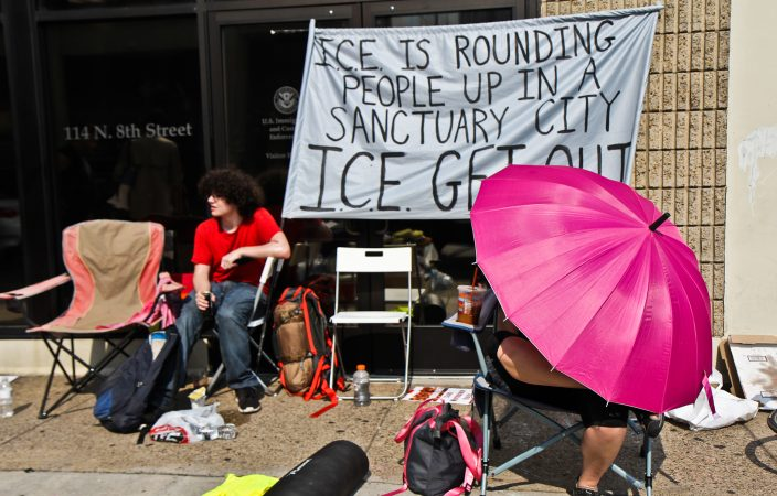 An encampment is protesting ICE outside of their headquarters at 8th and Cherry streets in Philadelphia. (Kimberly Paynter/WHYY)
