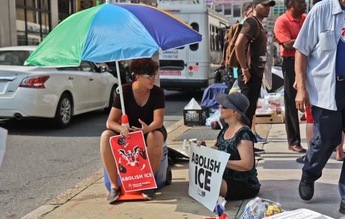 An encampment of protesters is calling for the end of ICE outside of its office at Eighth and Cherry streets in Philadelphia. (Kimberly Paynter/WHYY)
