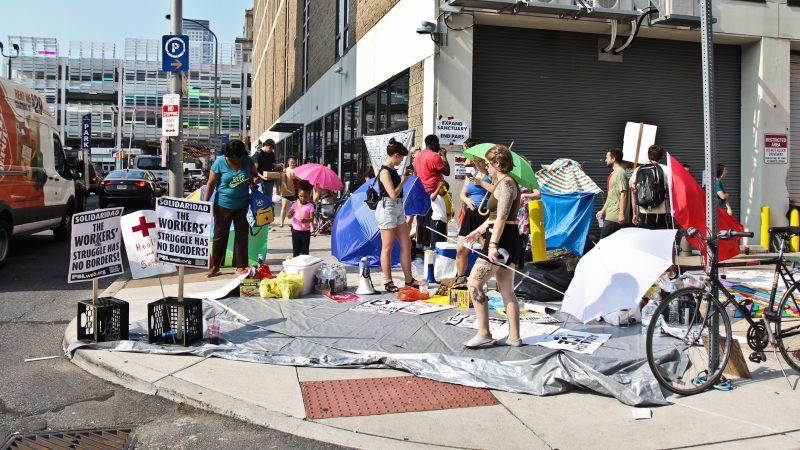 Demonstrators protest ICE outside of the office at Eighth and Cherry streets in Philadelphia. (Kimberly Paynter/WHYY)