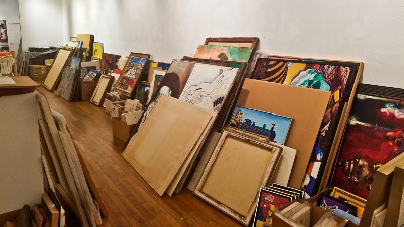 Thousands of pieces of art are sorted on the ground floor of the Rodger LaPelle Galleries building. (Peter Crimmins/WHYY)