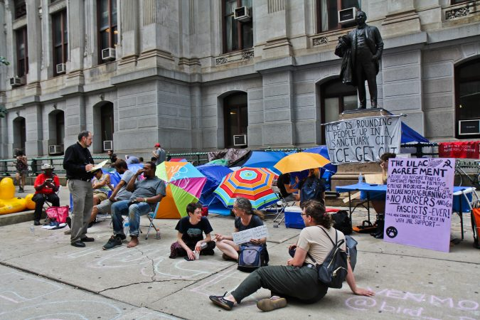 Immigration policy protesters have moved from the ICE headquarters at Eighth and Cherry streets to City Hall and are asking Philadelphia Mayor Jim Kenney to end an agreement with ICE. (Kimberly Paynter/WHYY)