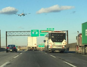 Cars and trucks share the northbound lanes of the New Jersey Turnpike near Newark, N.J. (Alan Tu/WHYY)