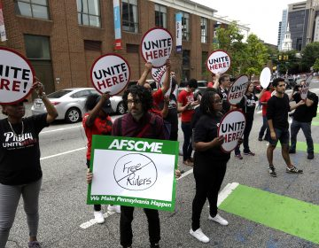 Union activists stand in the road as they participate in a protest by the Philadelphia Council AFL-CIO Wednesday June 27, 2018 in Philadelphia. The protesters denounced Wednesday's U.S. Supreme Court ruling that government workers can't be forced to contribute to labor unions that represent them in collective bargaining, dealing a serious financial blow to organized labor. (AP Photo/Jacqueline Larma)