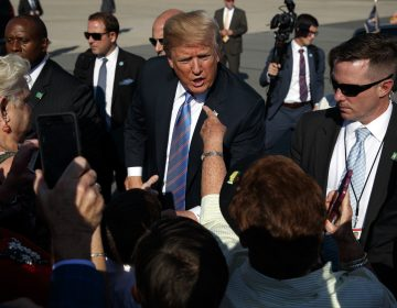 President Donald Trump greets supporters after arriving at the Greenbrier Valley Airport in Lewisburg, W.Va., before attending a