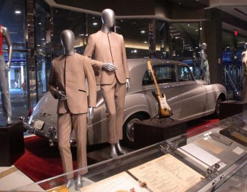 This July 5, 3018 photo shows suits worn by the Beatles during an early tour of America in front of the Rolls Royce automobile owned by Elvis Presley, part of a large collection of music memorabilia on display at the Hard Rock casino in Atlantic City, N.J. (Wayne Parry/AP Photo)