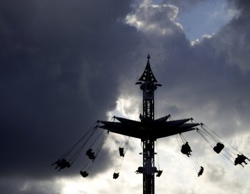 People ride on the Sky Flyer at the State Fair Meadowlands carnival on July 5 in East Rutherford, N.J. (AP Photo/Julio Cortez)