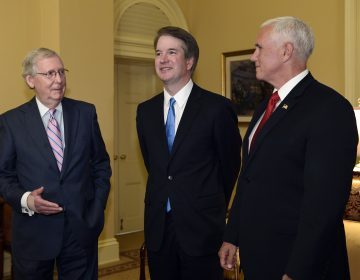 Senate Majority Leader Mitch McConnell of Ky., (left), speaks as he talks about Supreme Court nominee Brett Kavanaugh, (center), as Vice President Mike Pence, (right), listens, during a visit Capitol Hill in Washington, Tuesday, July 10, 2018. Kavanaugh is on Capitol Hill to meet with Republican leaders as the battle begins over his nomination to the Supreme Court. (Susan Walsh/AP Photo)