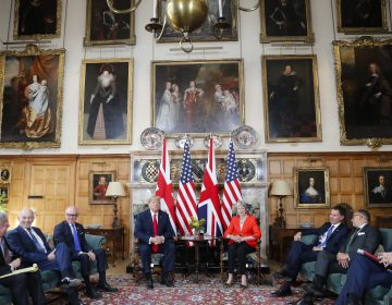 U.S. President Donald Trump, (center left), with British Prime Minister Theresa May, (center right) are seated during their meeting at Chequers, in Buckinghamshire, England, Friday, July 13, 2018. (Pablo Martinez Monsivais/AP Photo)
