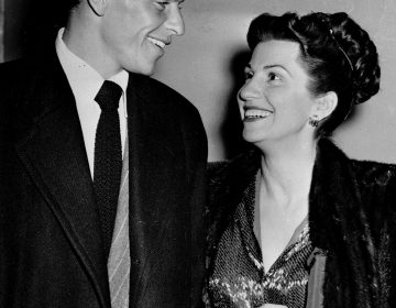 In this Oct. 23, 1946 file photo, singer Frank Sinatra and his wife Nancy smile broadly as they leave a Hollywood night club following a surprise meeting. Nancy Sinatra Sr., the childhood sweetheart of Frank Sinatra who became the first of his four wives and the mother of his three children, has died. She was 101. (AP Photo/File)