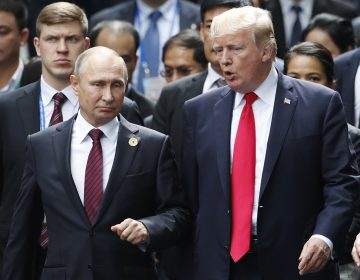 In this Nov. 11, 2017 file photo, U.S. President Donald Trump and Russia's President Vladimir Putin talk during the family photo session at the APEC Summit in Danang, Vietnam. The outcome of the first summit between the unpredictable first-term American president and Russia's steely-eyed longtime leader is anybody's guess. With no set agenda, the summit could veer between spectacle and substance. As Donald Trump and Vladimir Putin head into their meeting, Monday, July 16, 2018 in Helsinki, here's a look at what each president may be hoping to achieve(Jorge . Silva/Pool Photo via AP, File)