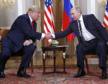 U.S. President Donald Trump, left, and Russian President Vladimir Putin shake hand at the beginning of a meeting at the Presidential Palace in Helsinki, Finland, Monday, July 16, 2018. (