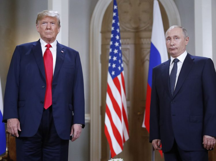 President Donald Trump and Russian President Vladimir Putin pose for a photograph at the beginning of a one-on-one meeting at the Presidential Palace in Helsinki, Finland. (AP Photo/Pablo Martinez Monsivais)