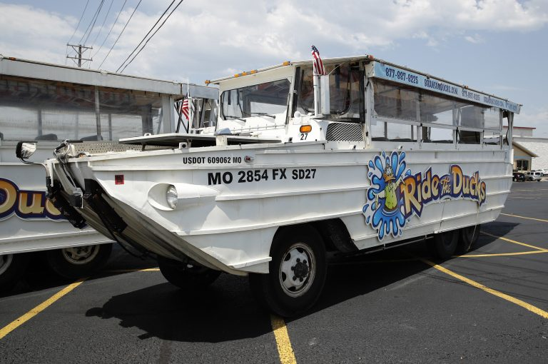 A duck boat sits idle in the parking lot of Ride the Ducks, an amphibious tour operator in Branson, Mo. Friday, July 20, 2018. The amphibious vehicle is similar to one of the company's boats that capsized the day before on Table Rock Lake resulting in 17 deaths. (Charlie Riedel/AP Photo)