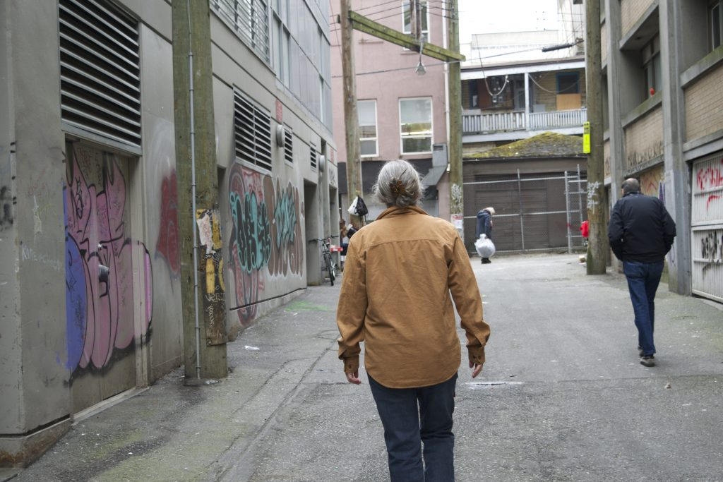 Longtime Vancouver resident and activist Ann Livingston in the alley next to the former space of the Vancouver Area Network of Drug Users, a group she helped found. Photo by Elana Gordon, WHYY