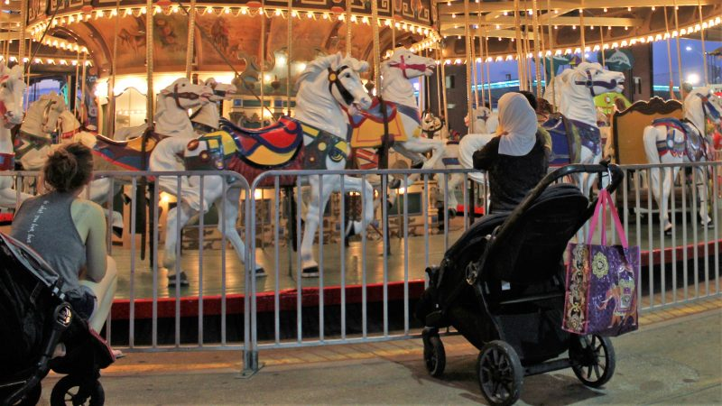 The carousel at Gillian's Wonderland Pier on the Ocean City Boardwalk dates from 1926 and remains a favorite of young riders. (Bill Barlow/for WHYY)