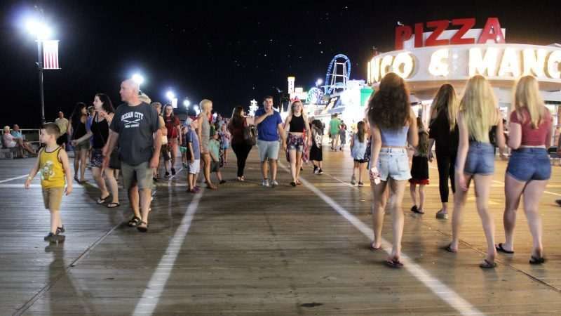 The Boardwalk on a summer night is the place to see and be seen. (Bill Barlow/for WHYY)