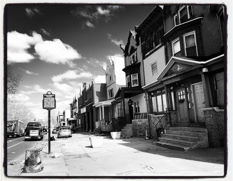 A historical marker on 33rd Street identifies the home of jazz great John Coltrane, but the house itself stands vacant and neglected.