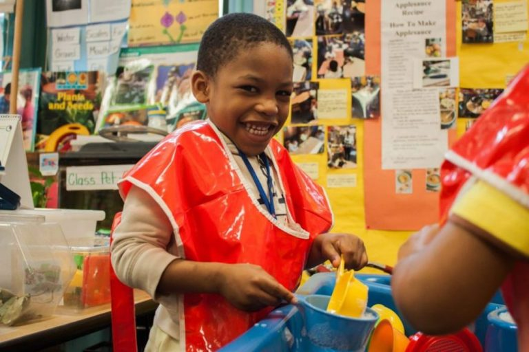 Josiah Taft, 4, played at the water table in his public preschool classroom at P.S. 3 in Brooklyn in 2016. New York is one of a handful of big American cities that offer universal preschool. Photo: Jamie Martines for The Hechinger Report
