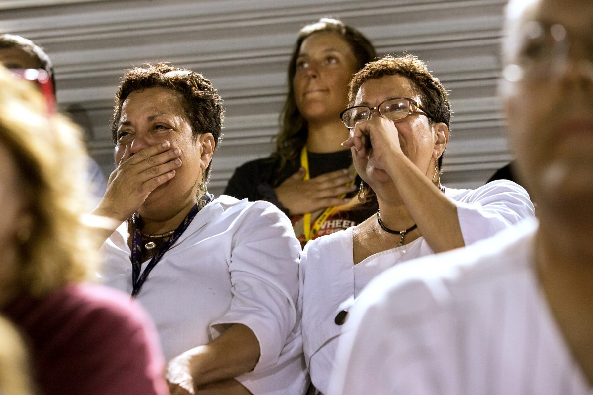 Twin sisters Lee Ann Riley, left, and Linda Riley watch the Cadets' first home performance. It was the first time they had seen the corps perform in decades.