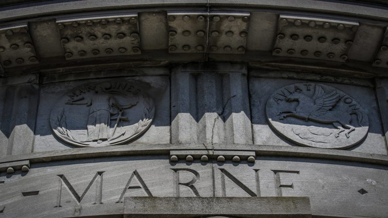 The names of World War I battles and medallions of the armed forces are carved around the top of the Atlantic City monument. (Anthony Smedile for WHYY)