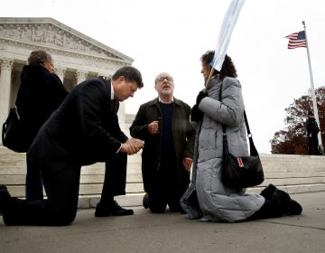 The Rev. Brad Wells, left, the Rev. Patrick Mahoney and Paula Oas, kneel in prayer in front of the Supreme Court, as the court hears the Masterpiece Cakeshop case. (Jacquelyn Martin/AP)