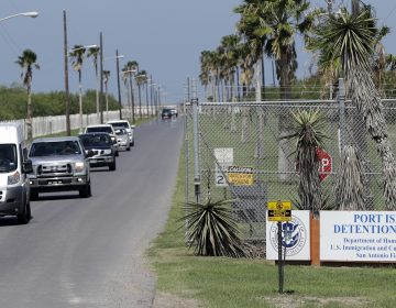 All day, unmarked white vans and chartered buses carrying the migrant children released from shelters across the country roll into the parking lot of the Port Isabel Detention Center in south Texas. (David J. Phillip/AP)