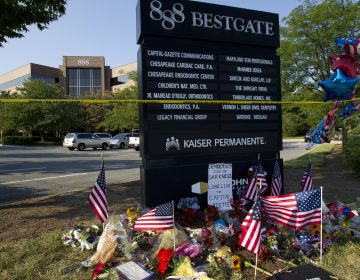 A makeshift memorial is seen at the scene outside the office building housing The Capital Gazette newspaper in Annapolis, Md., on Sunday.