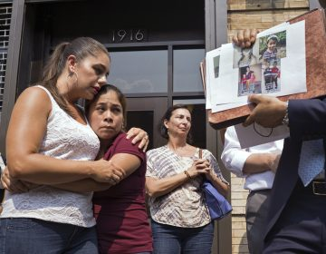 Yeni Gonzalez (center), a Guatemalan mother who was separated from her three children at the U.S.-Mexico border, is embraced by volunteer Janey Pearl Starks as pictures of other children separated from their families are displayed during a news conference on Tuesday in New York City. Gonzalez saw her children in a New York City facility for the first time since mid-May. (Craig Ruttle/AP)