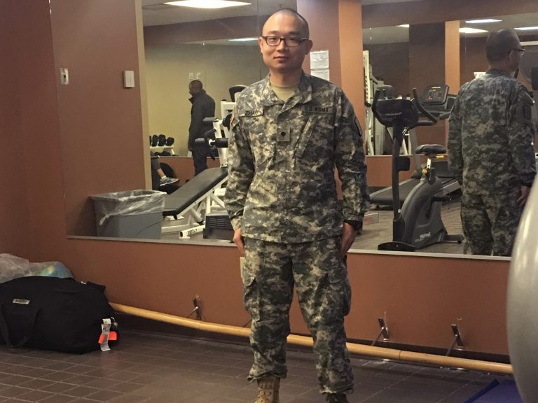 This photo provided to the AP by Panshu Zhao shows Zhao in uniform on Feb. 11, at a U.S. Army Reserve installation in Houston. Zhao is one of dozens of immigrant military recruits and reservists who have been waiting for years to deploy but were recently discharged with little explanatio