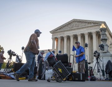 News crews set up in front of the Supreme Court early Monday morning in Washington, D.C. President Trump is expected to announce his choice for Supreme Court justice Monday evening.