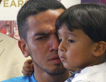 Javier Garrido Martinez holds his 4-year-old son after they were reunited on July 11, 2018, in New York. (Robert Bumsted/AP)