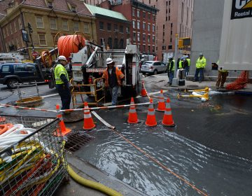 Verizon crews pump water from an access tunnel in Manhattan in 2012 after flooding from Superstorm Sandy knocked out underground Internet cables. (Stan Honda/AFP/Getty Images)