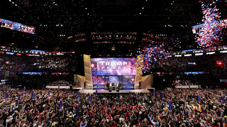 Then-candidate Donald Trump onstage with his running mate, Mike Pence, and their families at the end of the 2016 Republican National Convention in Cleveland. Republicans have chosen Charlotte, N.C., a city that hosted Democrats' convention in 2012, to host their 2020 convention. (Alex Wong/Getty Images)