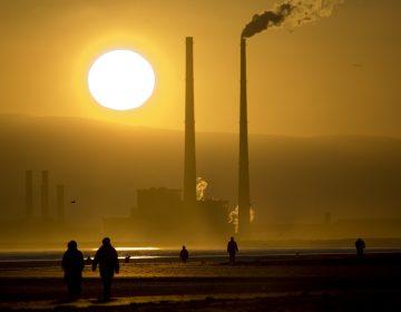 Smokestacks loom over Bull Island, northeast of Dublin, in 2008. (Dave Walsh/VW Pics/UIG via Getty Images)