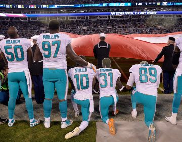 Miami Dolphins players kneel during the national anthem before their game against the Carolina Panthers at Bank of America Stadium on Nov. 13, 2017, in Charlotte, N.C. (Grant Halverson/Getty Images)