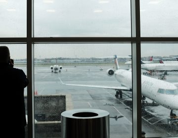 A passenger looks over planes sitting on the tarmac at LaGuardia Airport in New York City on Nov. 22. A previously undisclosed TSA program flags passengers for observation, and undercover air marshals observe their behavior — including whether they make calls or send texts as they travel, The Boston Globe reports. (Spencer Platt/Getty Images)